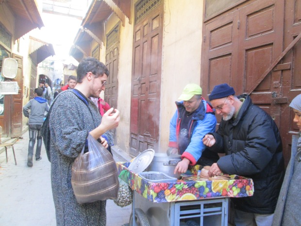Biggie- when he first started traveling in Morocco. He would approach anybody innocently. Here, he's buying le snails from this seller